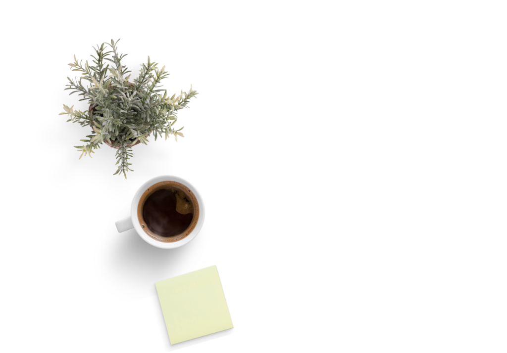Plant, coffee, and post-it over a white background