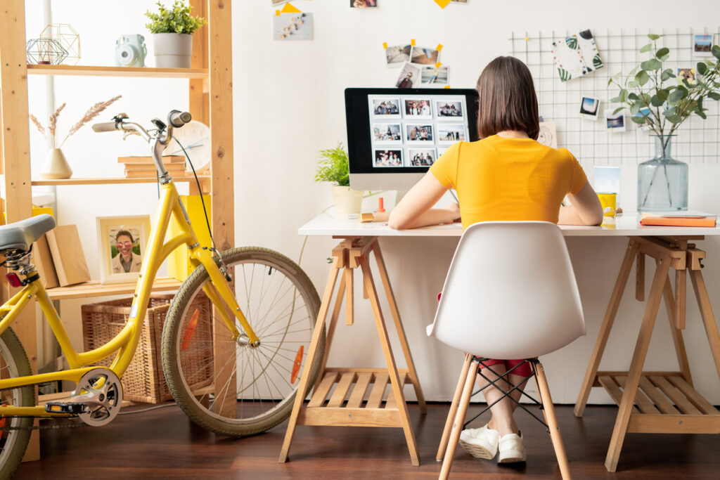 A woman finding inspiration for her e-commerce email design.