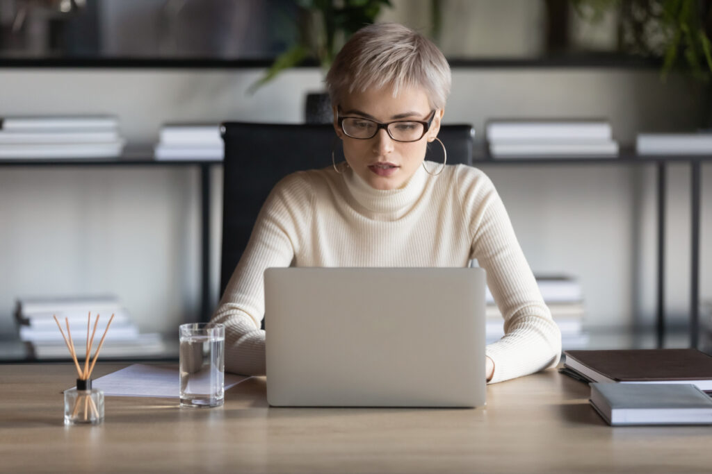 Woman writing a post purchase email.