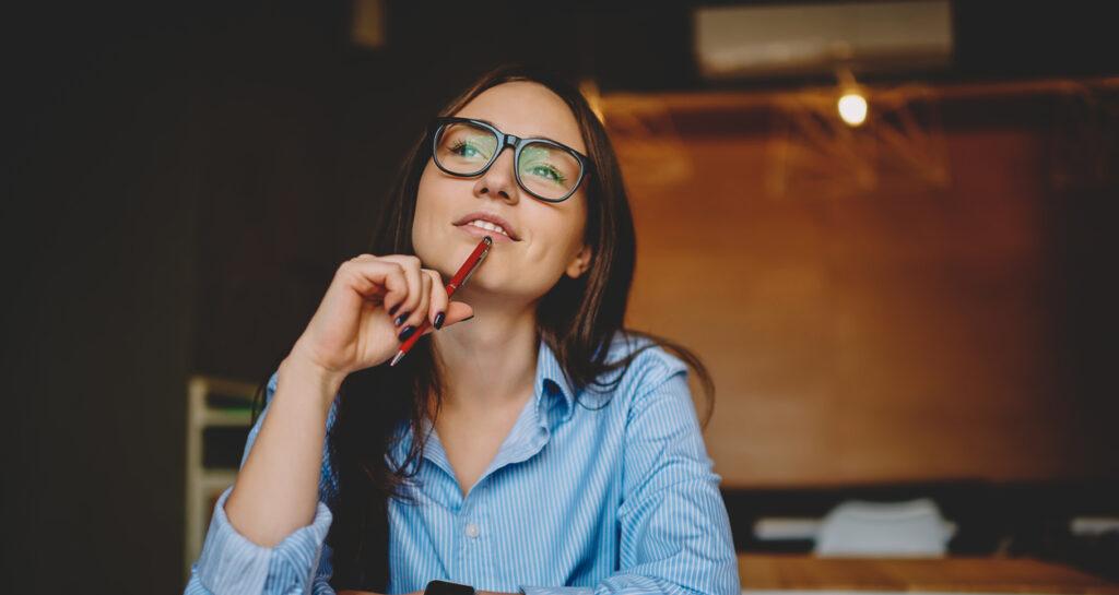 A woman thinking of customer winback strategies.