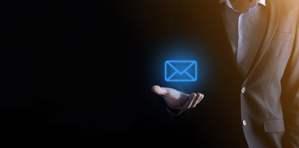 Male holding an email hologram
