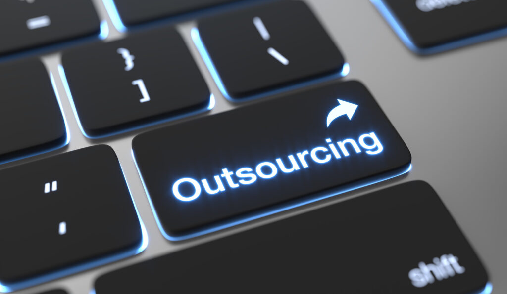 """Keyboard with a button that says """"outsourcing"""""""