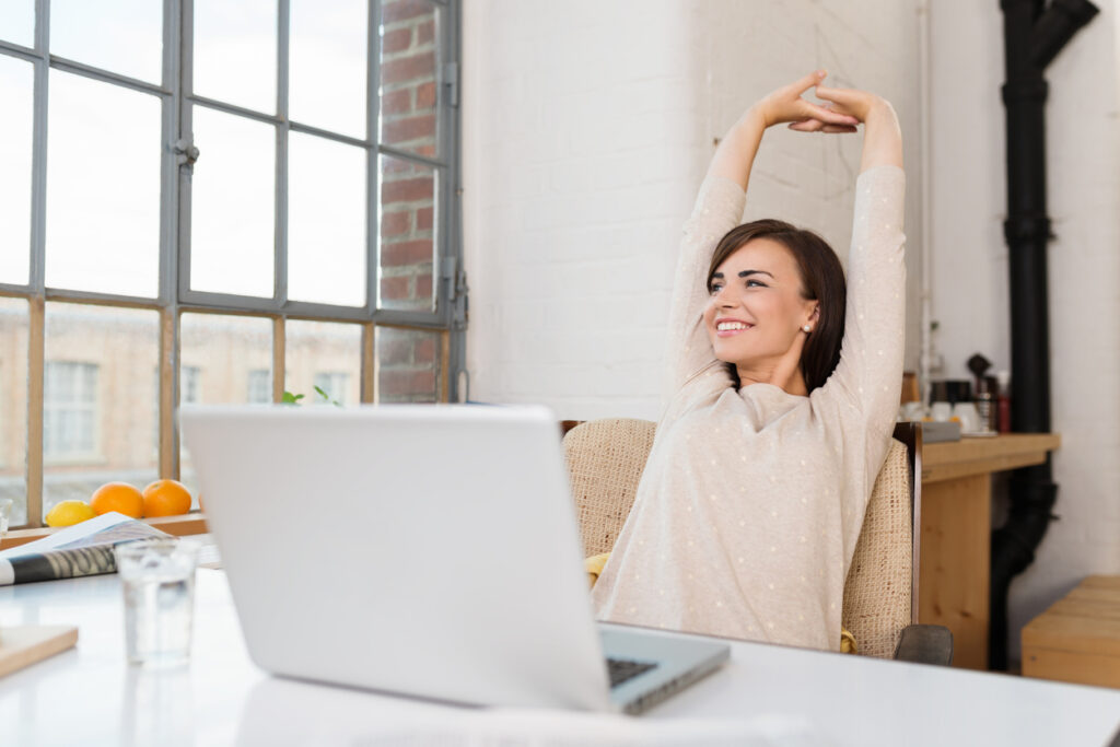 A woman happy about the benefits of email automation.
